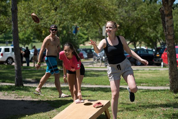 AYA members compete in bean bag toss game