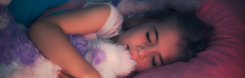 Young girl sleeping with stuffed animal