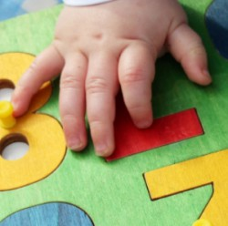 baby's hands on number game
