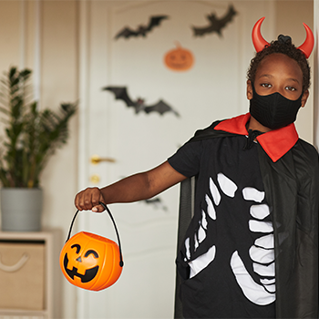 Child dressed as a devil for Halloween