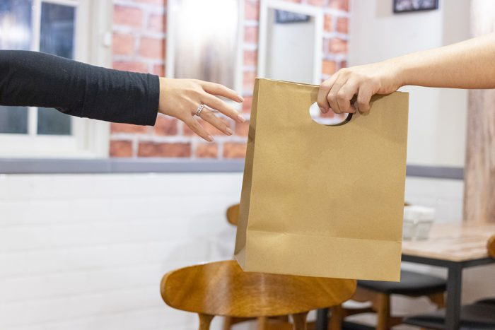 Donations in a paper bag