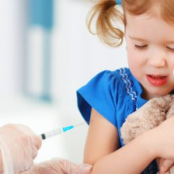 Young girl getting shot, tightly hugging teddy bear