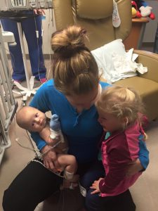 Shelby Herlick in the hospital with Charlie and her other child