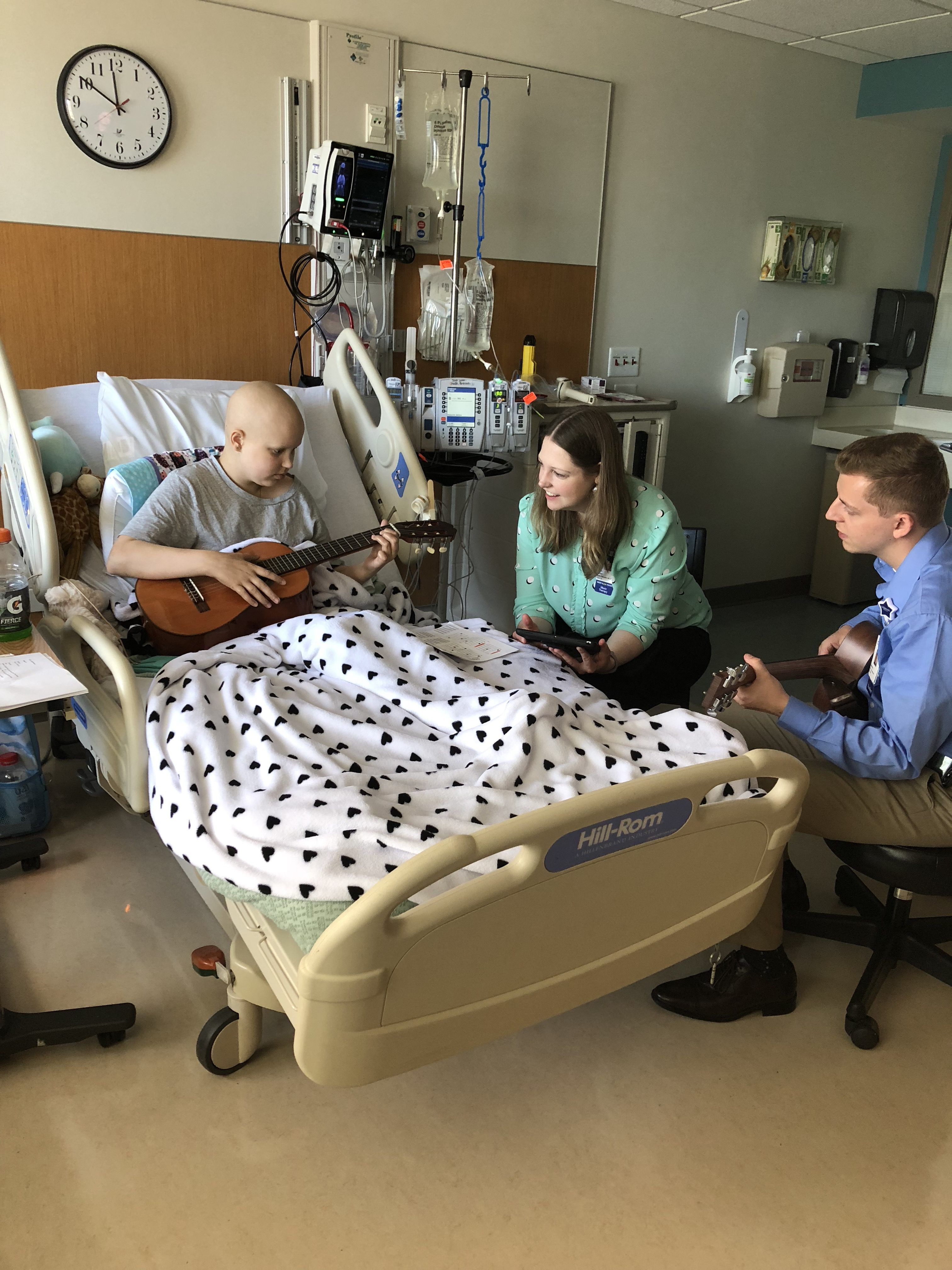 Cancer patient, Mia, with Children's music therapists