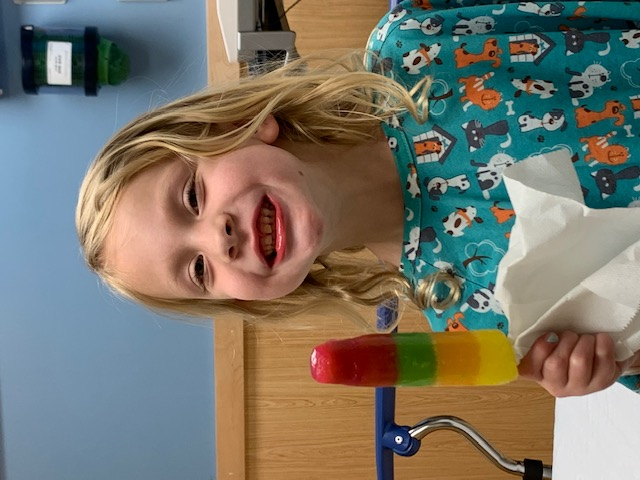 Callie eating a popsicle after having her tonsils removed