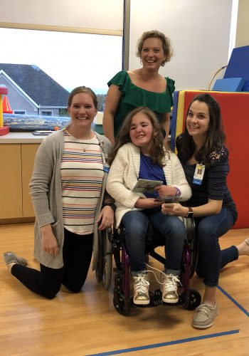 Addison with Miss Nina, physical therapist Kristin Penney and occupational therapist Erin Dedrich