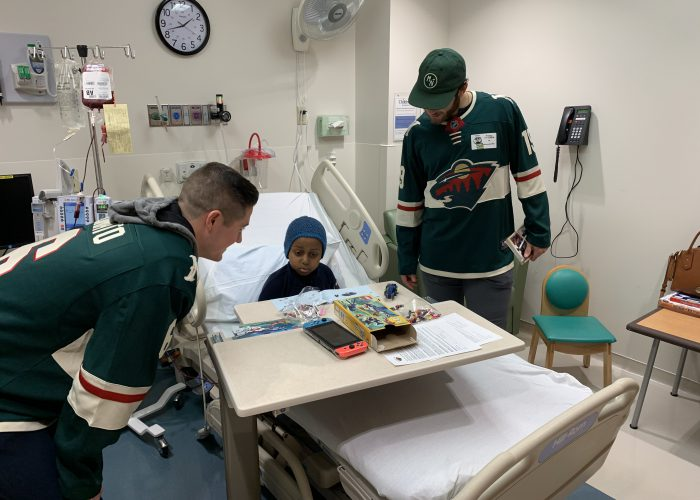 Minnesota Wild players visiting sick patients