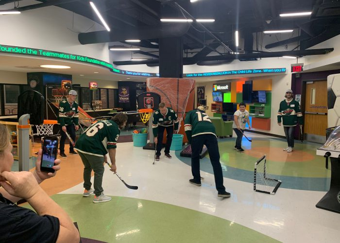 Minnesota Wild players playing hockey in star studio