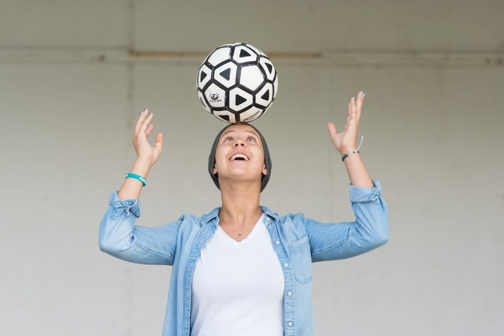 Trina balancing a soccer ball on her forehead
