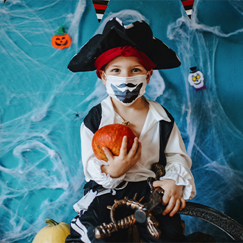 Little boy dressed as a pirate for Halloween