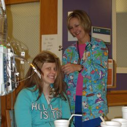 Jacqueline and one of her care team members doing hair at Children's Minnesota.